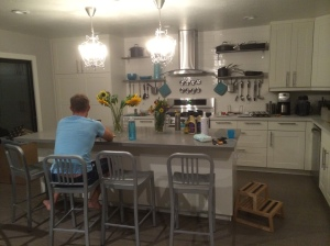 This isn't the best photo I've ever taken but it shows the kitchen really nicely. We removed the wall separating the rooms, added an island and updated the flooring, lighting, cabinets, appliances and countertops (everything really!).
